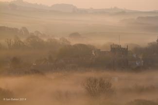 Village in early morning mist